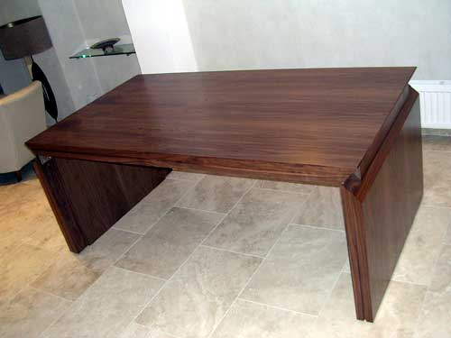 Drop-leaf Walnut dining table with raised leaf