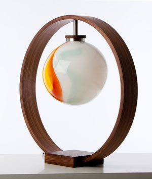Solitaire Lamp in American Walnut and stainless steel with a hand-blown glass shade